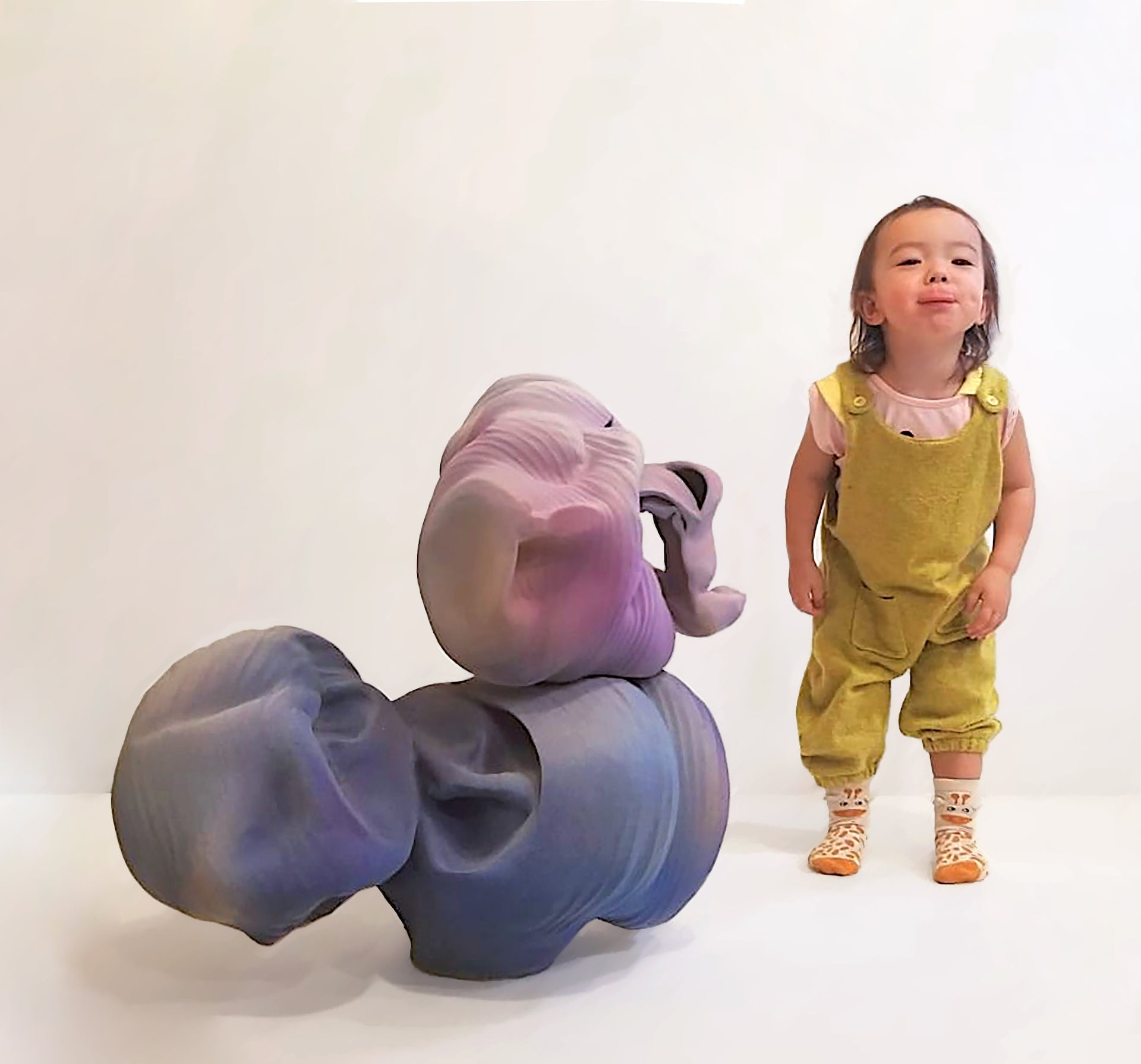Aya Jacques pictured with It's a Toy Violet Brain, a 2018 work by Anne Marie Laureys. Photo © Jason Jacques Gallery
