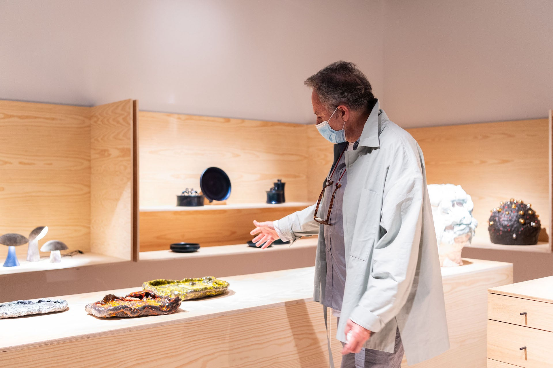 Architect and Design Miami/ Basel Best in Show juror Lee Mindel gives a tour of Pierre Marie Giraud's booth. Photo © World Red Eye