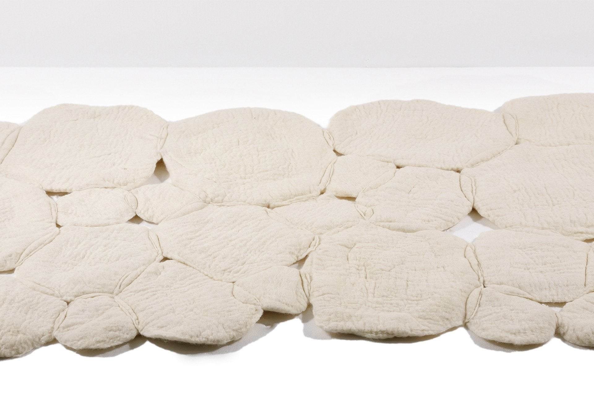 Nevoeiro Rug by Inês Schertel for Mercado Moderno. Schertel created this one-of-a-kind rug using a 6,000-year-old felting technique. The wool comes from the herd of Textel sheep that live on her ranch in Rio Grande do Sul. Photo © Mercado Moderno