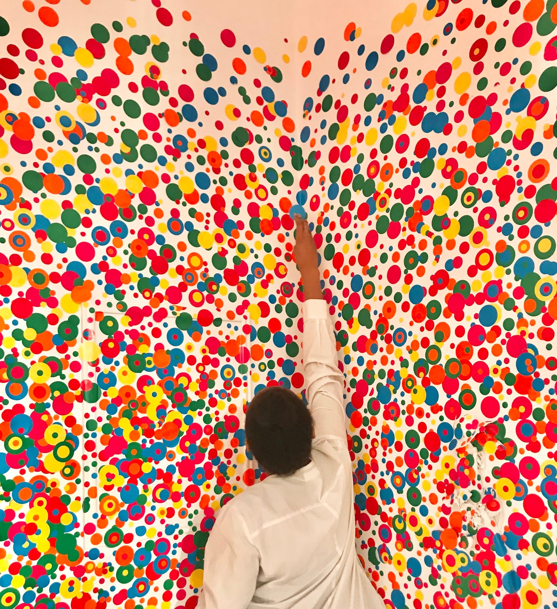 """""""To my mind, design is colorful, fun, layered, diverse, and playful,"""" Nomsa Moya notes. """"There's room for everyone to express themselves in the best way they know how.""""  Installation view of The Obliteration Room by Yayoi Kusama at the Art Gallery of Ontario, 2018.  Photo © Nicole Nomsa Moyo"""