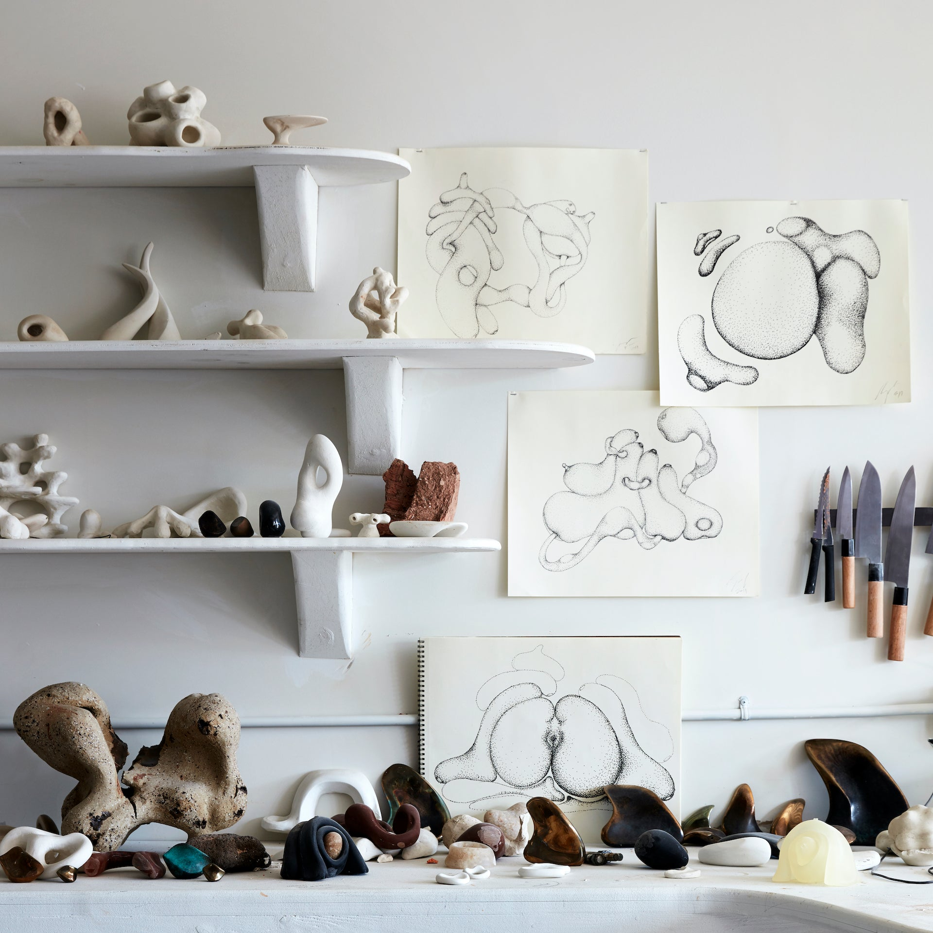 Fertility form drawings and maquettes in Gregory's studio. Photo © Stephen Kent Johnson