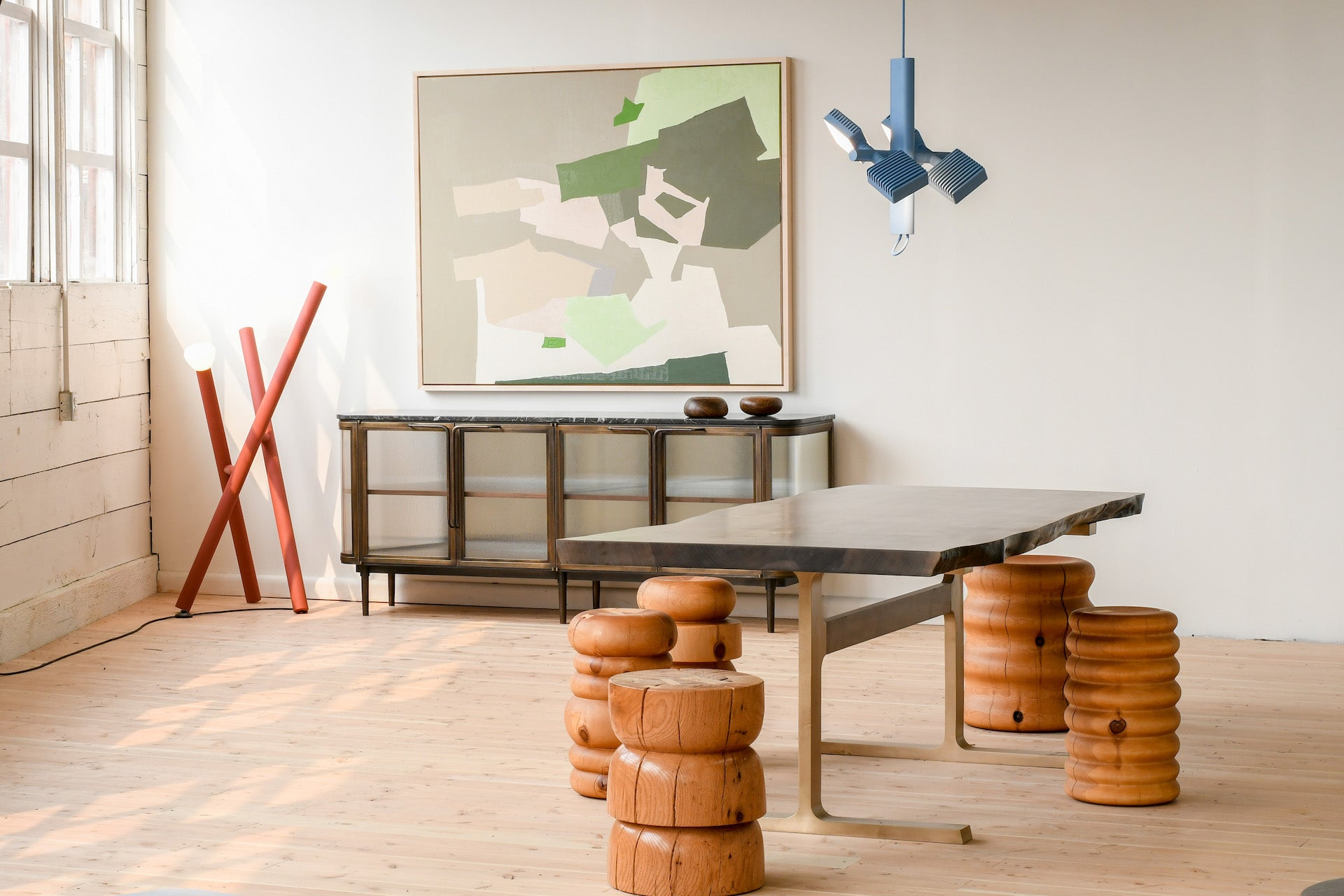 """Martin's Joinery Table with Dan John Anderson Stools, Lambert et Fils Lighting, and New Format Studio Credenza at Alpenglow Projects. """"All of these designers I have met on the fair circuits since my career began, and I am honored to be representing them in my new gallery space,"""" Martin says. Photo © Jeff Martin"""