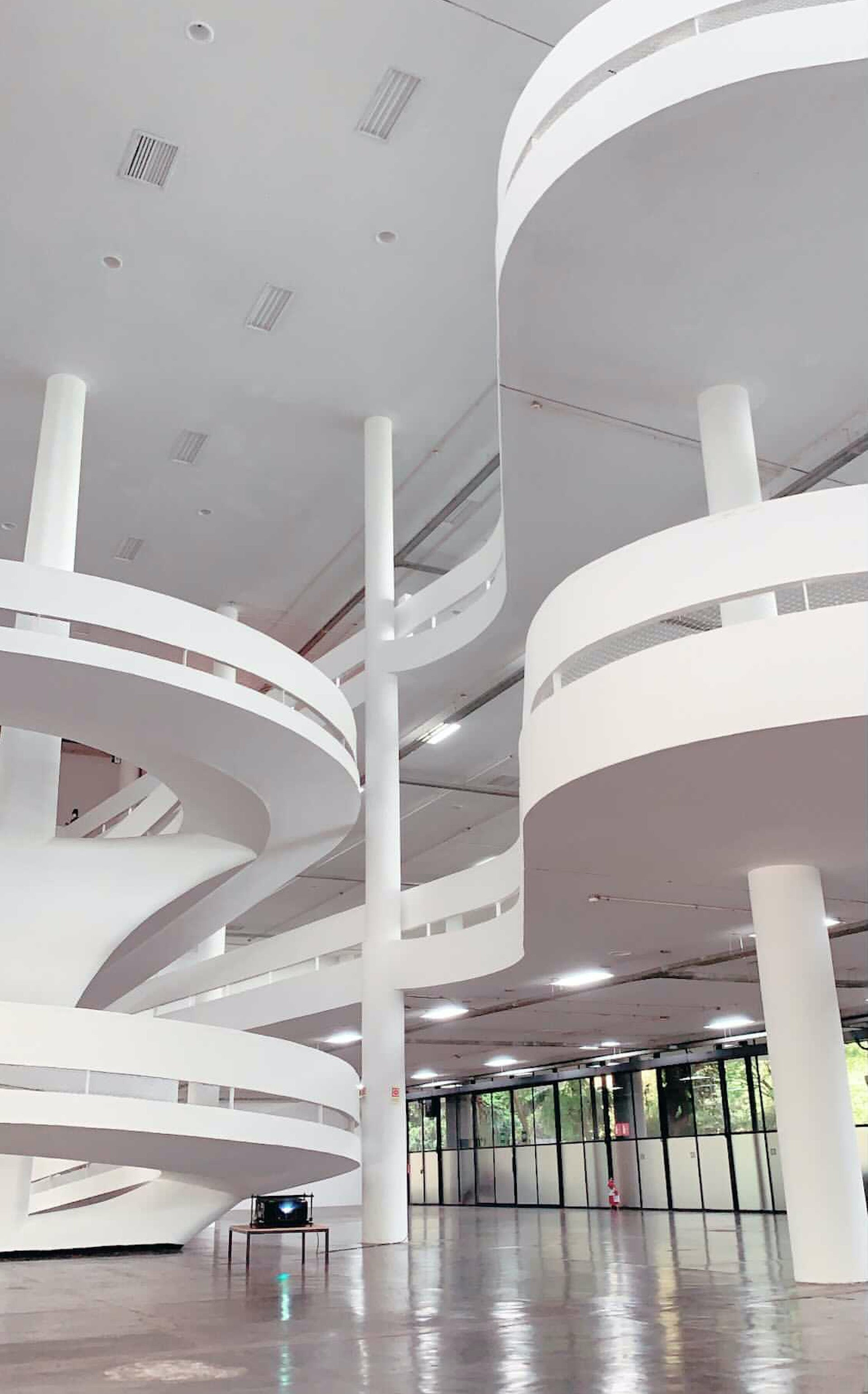 """Inside the Ibirapuera Biennial Building in São Paulo. """"An icon of architecture and design, Oscar Niemeyer was the master of curves,"""" Schertel says. """"This image shows the interior of a building that beautifully represents our design heritage."""" Photo © Ricardo Gaioso"""