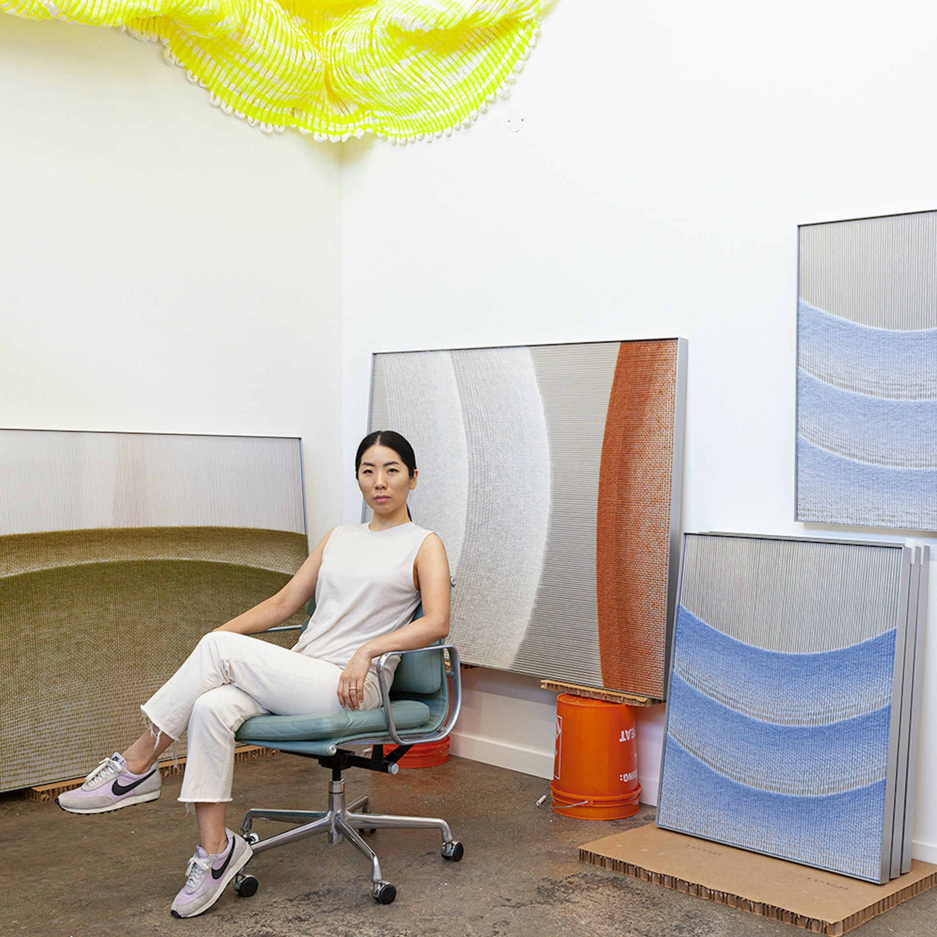 The artist with pieces from her Falling Fence and Subsuming Ellipse series. Photo © Mimi Jung