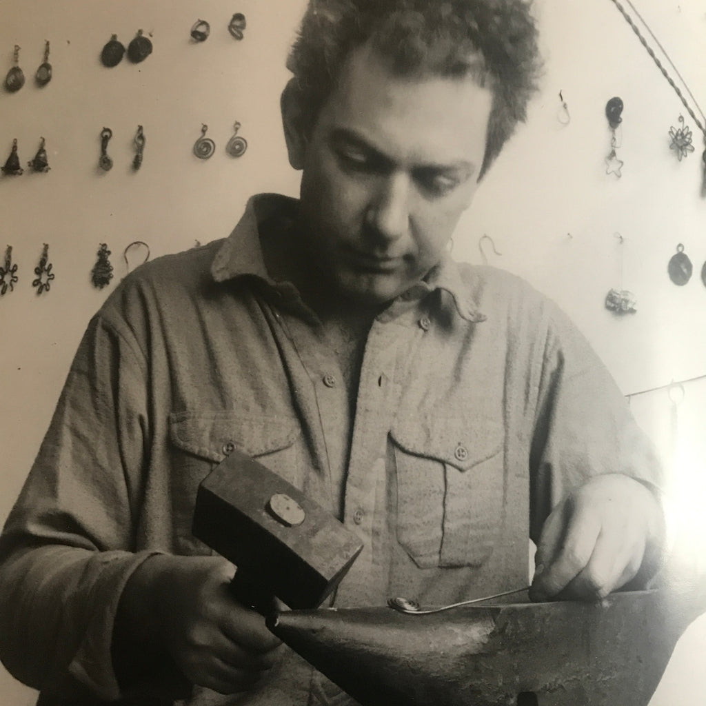 Portrait of Alexander Calder from the book Calder Jewelry. Photo © Maria Robledo