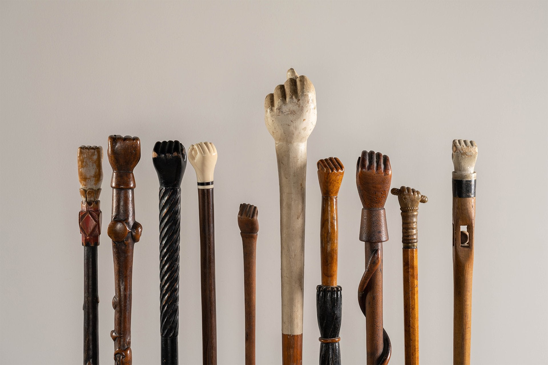 """Power to the People"": a Collection of Ten Walking Sticks with Clinched Fists"