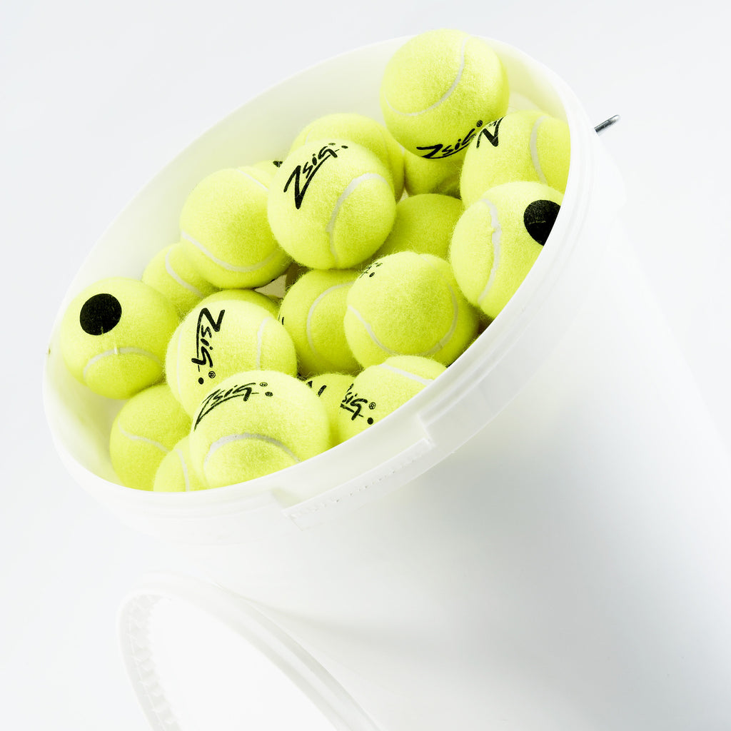 Zsig's Black Dot tennis ball for coaching & practice. Yellow with black dot for easy ID.