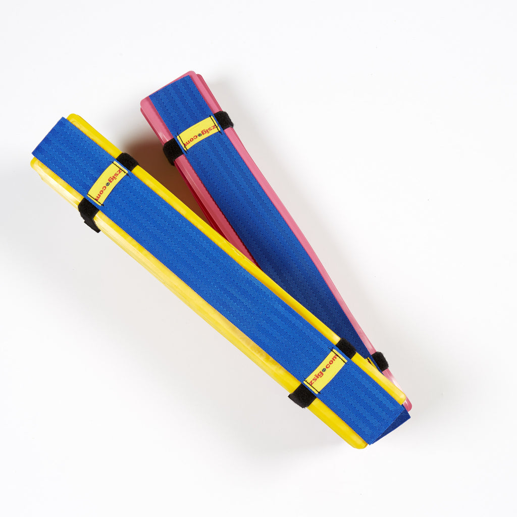 Pink & yellow sets of Throw down lines packed in their easy-to-carry harnesses.