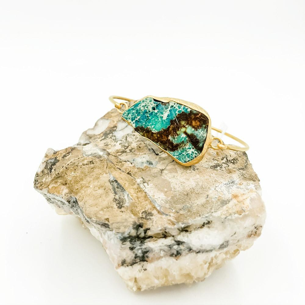 Turquoise with a beatiful bold dark brown vein.