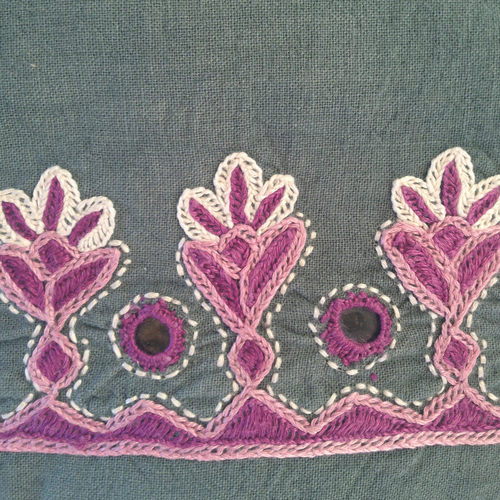 hand embroidery appliqué work in grey
