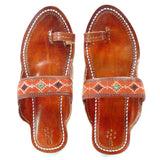 hand embroidered leather sandals in orange