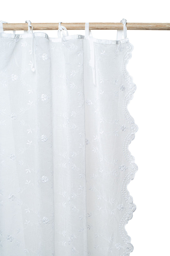 The Victoria embroidered voile curtain adds that special touch to your window. This design is timeless and will fit any interior. Finished with velvet ribbons and a lovely scallop on both lengths.