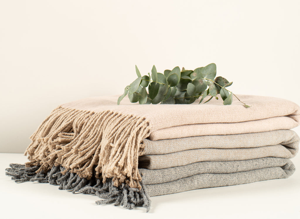 Looking for a snuggly blanket but not into wool? Then Jane is the blanket for you. This 80 % cotton mix is the softest blanket in our collection. Perfect for any occasion of the day. Available in 3 lovely timeless colors!