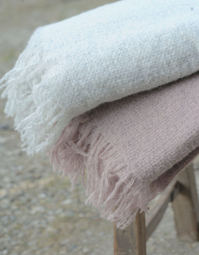This snuggly blanket is a must have for everyone. Because of its alpaca mix it can be used all year round. Warm and snug in the winter and just perfect for those chilly summer evenings in the garden.