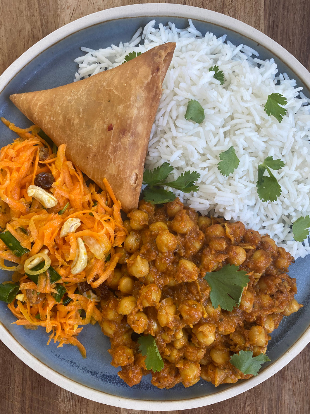 #6 Delivered cold - chana masala with basmati rice, vegetable samosa and Bombay carrot salad