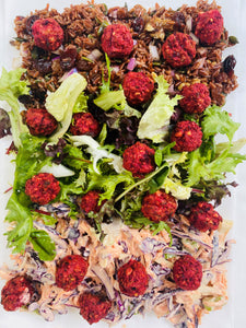 Red rice & fruits with coleslaw & beetrot falafels platter