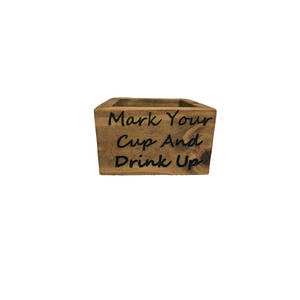 Plastic party cup holder made from solid wood with painted lettering that say mark your cup and drink up