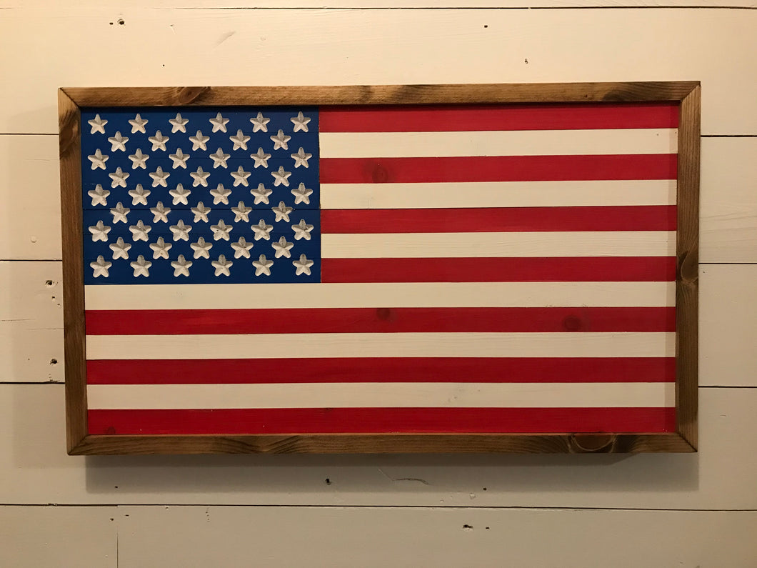 Framed American Flag - Painted is an American flag made of wood, hand painted with a wood frame.