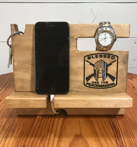 Phone docking station for police officers with space for a phone, keys, watch, glasses, wallet and loose change.