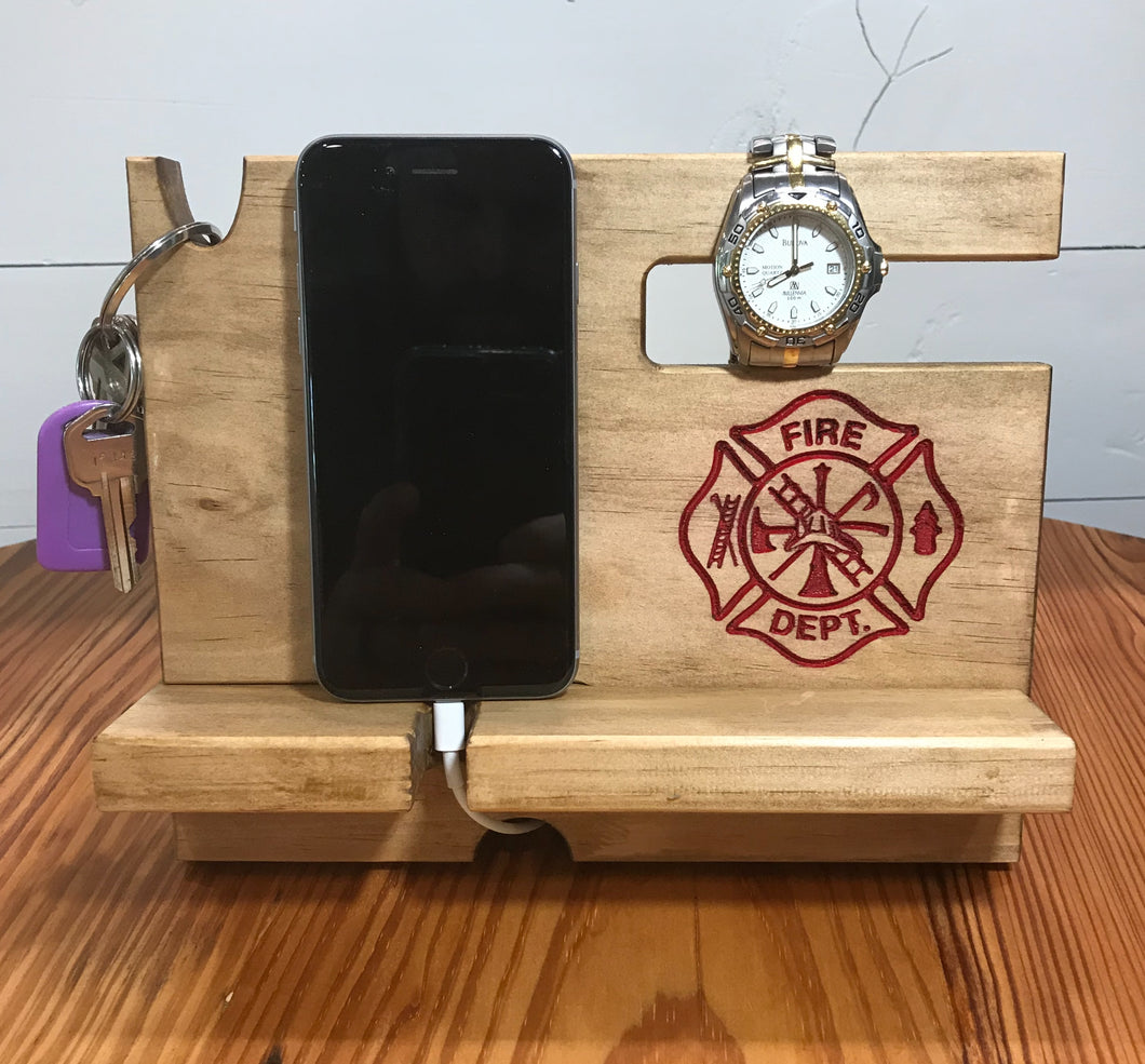 Phone docking station for firefighters with space for a phone, keys, watch, glasses, wallet and loose change.
