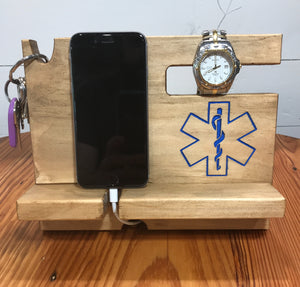 Phone docking station for EMS workers with space for a phone, keys, watch, glasses, wallet and loose change.