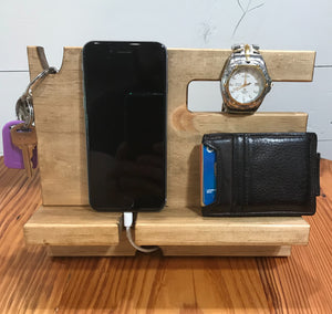 Phone docking station with space for a phone, keys, watch, glasses, wallet and loose change.