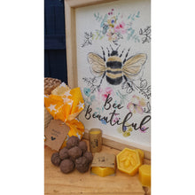 Load image into Gallery viewer, Seed bomb pack, with yellow cotton wrap. Surrounded with items incuded in purchase-wildflower bee seed bombs and yellow beeswax block with bee design.