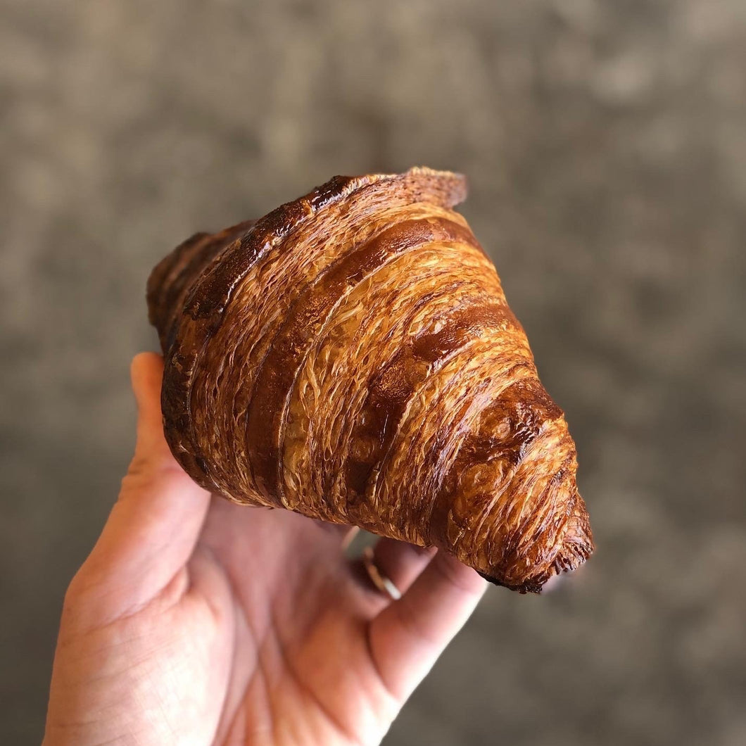 Hand Holding Bostock Bakery All Butter Croissant