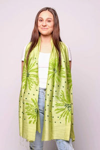 Woman wearing golden lime scarf with green pattern