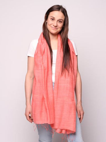 Woman wearing coral colored scarf