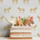 illustrated marigold yellow orange donkey on white background wallpaper pattern behind stack of books peel and stick