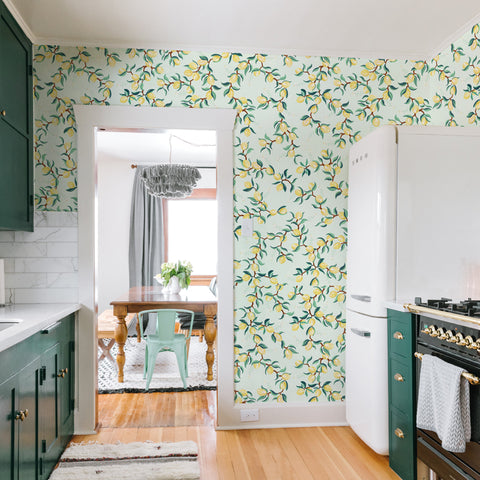 illustrated green leaves yellow lemon on mint green background wallpaper peel and stick pattern sample size