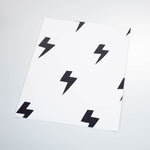 cartoon style black lightning design on white background wallpaper peel and stick pattern sample size