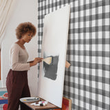 White background black crosshatch pattern wallpaper in room with artist peel and stick removable