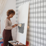 White background grey crosshatch pattern wallpaper in room with artist peel and stick removable
