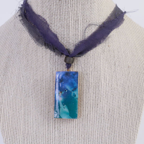 Boy Holding Fairy Pendant Necklace