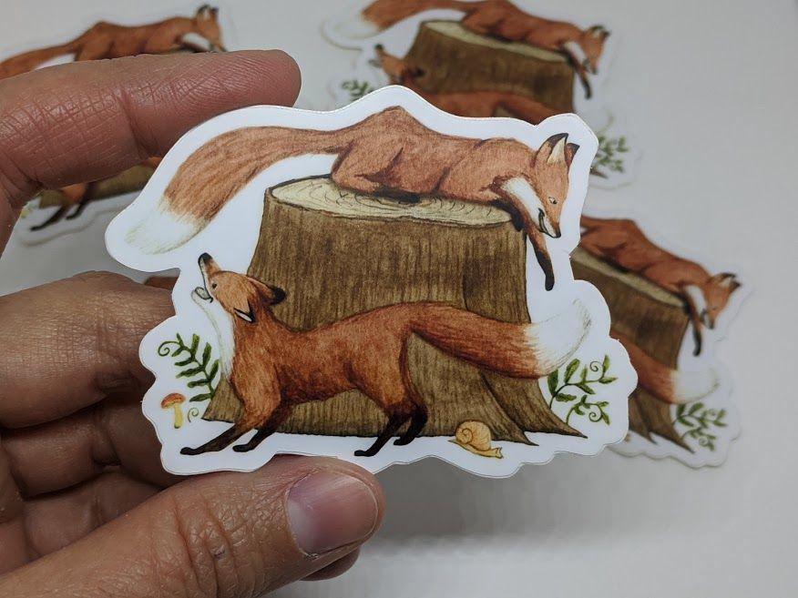 Two Foxes Playing Sticker by TursiArt