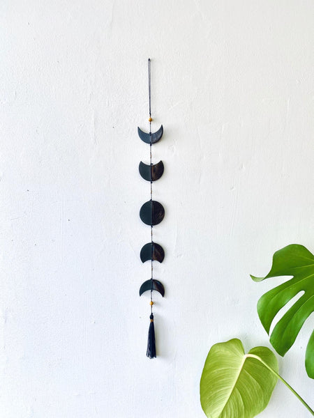 Black crescent moon ceramic wall hanging by Mana Dejah available at Local Assembly