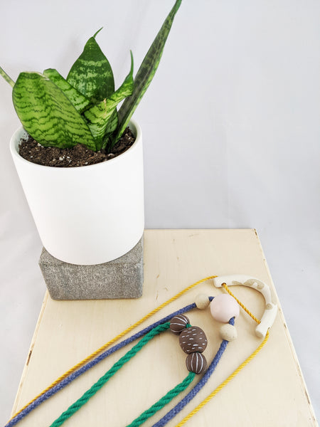 Handmade ceramic necklaces by Meg Hubert available at Local Assembly