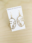 Gold face earrings by Meraki Collection available at Local Assembly