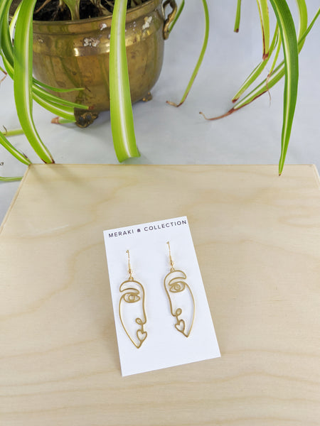 Gold face Ophelia earrings by Meraki Collection available at Local Assembly