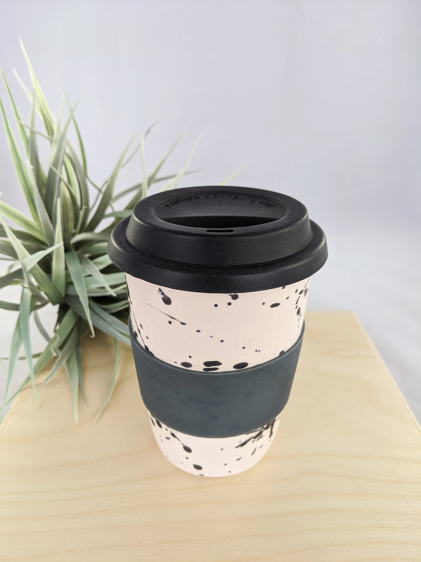 Pink and black speckled 16 oz to-go mug by Meg Hubert available at Local Assembly