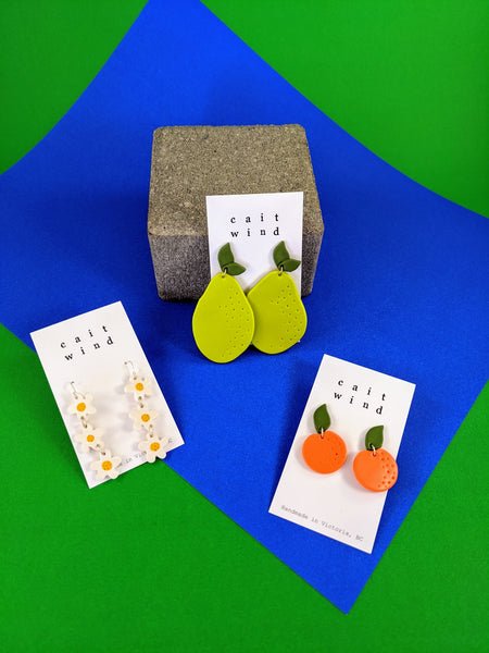 Orange, pear, and daisy earrings by Cait Wind available at Local Assembly