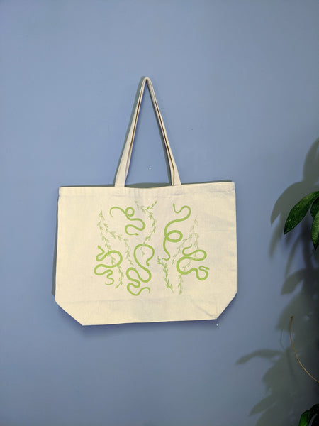 Large white snake print tote by Lizard Breath available at Local Assembly