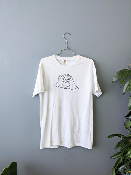 Embroidered heart hands tee by Embroiderline available at Local Assembly