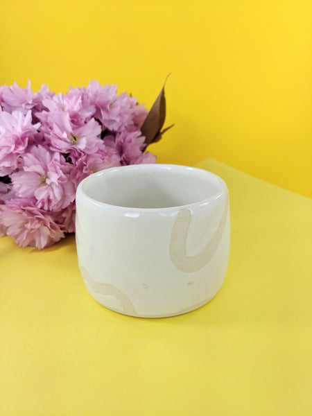 White glazed ceramic planter by From Tree to Sea available at Local Assembly