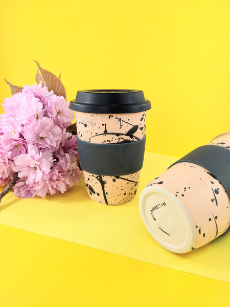 Pink and black splatter 16 oz ceramic to-go mug by Meg Hubert available at Local Assembly
