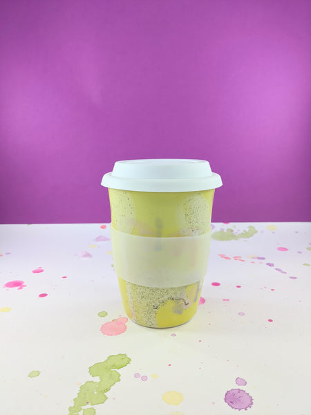 Yellow and white 16 oz ceramic to-go mug by Meg Hubert available at Local Assembly