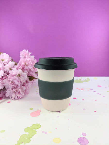 Pink and black 12 ounce to-go mug by Meg Hubert available at Local Assembly
