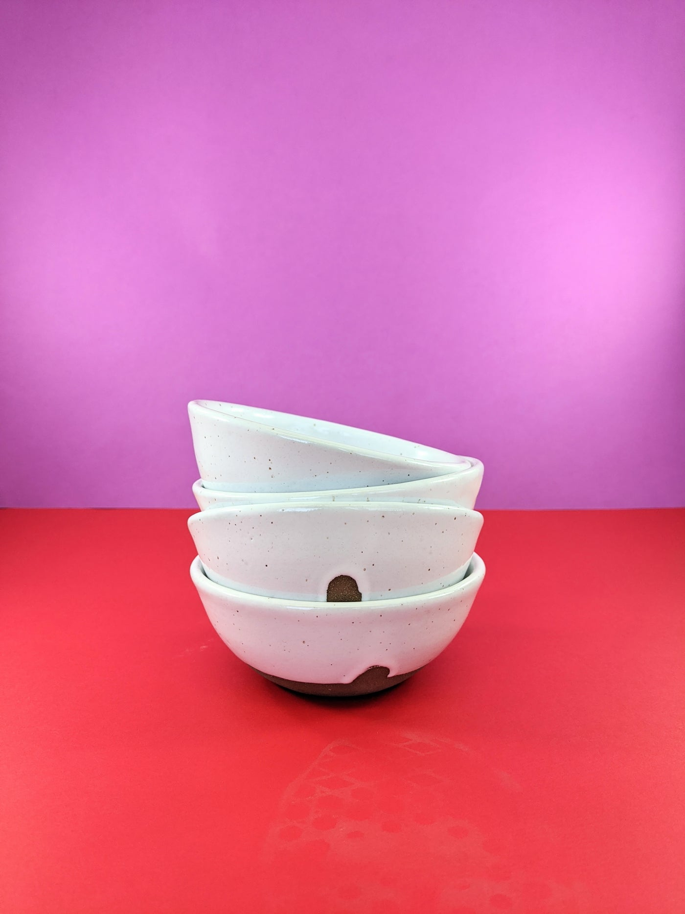White speckled ceramic bowl by Meg Hubert available at Local Assembly